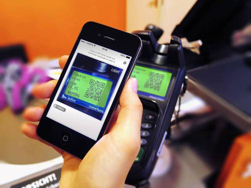Scan, confirm, done. Fast, easy and secure payment with Yapital via smartphone app (PRNewsFoto/Yapital Financial AG)