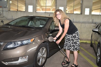 Lee Ann Riccardi, professor of art history and interim director of the college's Center for Global Engagement, plugs in her 2014 Chevy Volt.