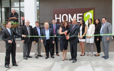 Grand Opening of the Home2 Suites by Hilton Long Island City ribbon cutting ceremony.  Pictured from left:  John Parker, (RHG), Ken Fisher (Cozen O'Connor), Peter Rudewicz (Hilton Worldwide), Martin Markowitz (NYC & Co), Yoni Bokser (Economic Development Officer from Queens Borough Presidents office), and owners Sandy, Jacob, Melissa, Jessica, Benika and Daniel Rad (RadSon Development) (PRNewsFoto/Real Hospitality Group)