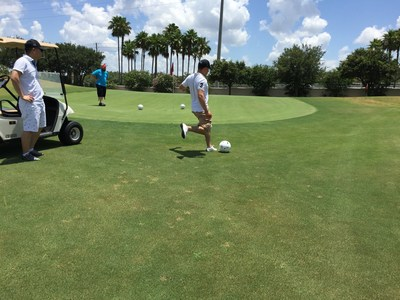 A veteran prepares to kick the ball in a game of footgolf with Wounded Warrior Project in Orlando, Florida on a recent hot summer day.