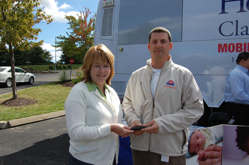 Sherri Browning, MOD Executive Director presents Crystal Award to Dave Howard, Farmers Pittsburgh AgencyPoint ...