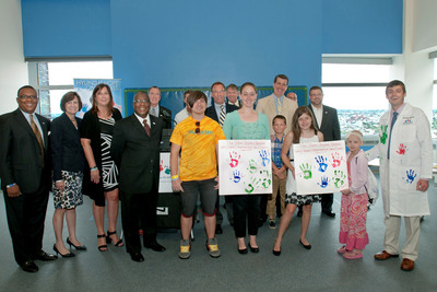 Hyundai Motor America representatives gather with 2013 Hyundai Scholar Dr. Gamper and pediatric cancer survivors to celebrate the Hope On Wheels $75,000 Scholar Grant awarded to the Johns Hopkins Sidney Kimmel Comprehensive Cancer Center, Division of Pediatric Oncology of Baltimore.  (PRNewsFoto/Hyundai Hope On Wheels)
