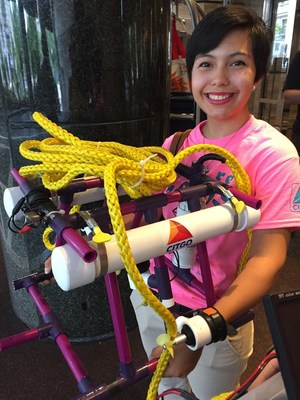 Moody High School student Natasha Sanchez demonstrates an underwater robot built by students from the CITGO Innovation Academy