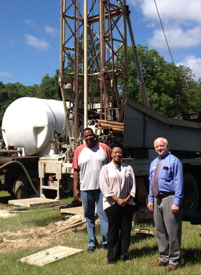Ben Hill County, GA -- Breaking ground on the first of eight water wells provided by the Water Well Trust are (L. to R.) Ben County Commissioner O.D. Netter Jr., Ben Hill County Development Authority Coordinator Courtney Whitman, and Ben Hill County Administrator Frank Feild. (PRNewsFoto/Water Well Trust)