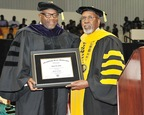 Grambling State University president Frank G. Pogue, Ph.D., bestows ceremonial regalia to James Colon, vice president of African American Business Strategy for Toyota Motor Sales, at the school's 2014 spring commencement recently. Colon received an honorary doctorate of laws for his advocacy of African-American participation in the automobile industry. (PRNewsFoto/Toyota Motor Sales, Inc.)