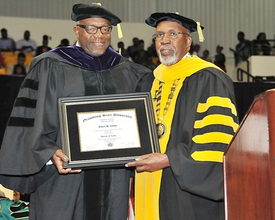 Grambling State University president Frank G. Pogue, Ph.D., bestows ceremonial regalia to James Colon, vice president of African American Business Strategy for Toyota Motor Sales, at the school's 2014 spring commencement recently.  Colon received an honorary doctorate of laws for his advocacy of African-American participation in the automobile industry.