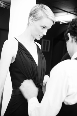Zac Posen fitting a model with his new Truly Zac Posen Social Occasion line exclusively at David's Bridal.