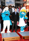 Smurfs Clumsy and Smurfette are joined by actor Anton Yelchin who voiced Clumsy. (PRNewsFoto/Sony Pictures Home Entertainment)