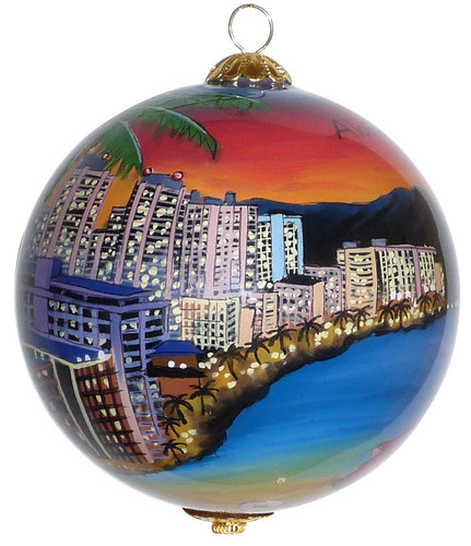 World famous Waikiki beach at sunset is hand painted from the inside of a glass ornament (PRNewsFoto/Maui by Design)