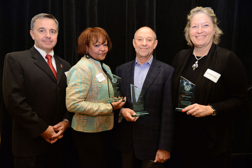 Pictured Left to Right: Michael Ruppal, Executive Director; Marylin Merida, Board President; Lew Sibert, ...