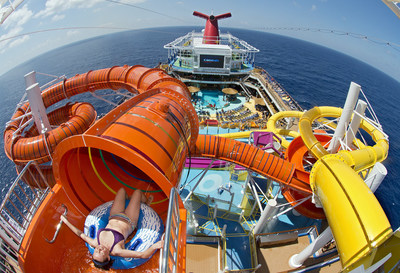 A guest prepares for an exhilarating ride down the Kaleid-O-Slide, a 455-foot-long tube slide on the new Carnival Vista which entered service this week in Europe.   Carnival Cruise Line's newest, largest and most innovative ship begins year-round Caribbean sailings from Miami in November 2016.