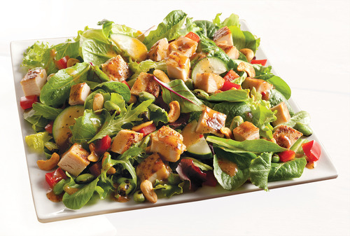 Wendy's is debuting two new permanent menu items to its premium salad line, the Asian Cashew Chicken and BBQ Ranch Chicken Salads. At only 380 calories for a full-size salad and 240 calories for a half-size salad, Wendy's new Asian Cashew Chicken Salad is a full flavored nutritious option.  (PRNewsFoto/The Wendy's Company)