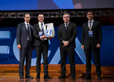 Davide Girelli, General Manager Europe and India, BorgWarner Morse TEC (left center), accepts a Best Powertrain EMEA Supplier 2014 Award from Scott Garberding, Global Head of Group Purchasing, Fiat Chrysler Automobiles (left); Alfredo Altavilla, Chief Operating Officer EMEA, Fiat Chrysler Automobiles (right center); and Paolo Sasso, Head of Powertrain Purchasing EMEA, Fiat Chrysler Automobiles (right), during the Qualitas Convention in Lingotto (Turin), Italy.