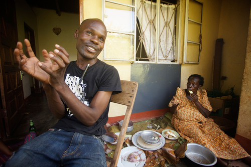 David Kato, one of Uganda's first openly gay activists, with his mother, Lydia Mulumba Nalongo. ...