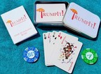 "TrumpIt! The ""Art of the Dealer"" game combines strategy and satire. Game package includes custom deck with orange Hearts and Diamonds, tokens, rules, and collectible metal box."