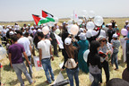 From a village near Jenin that borders on the 1967 line, OneVoice Palestine youth activists and locals released into Israel hundreds of helium balloons carrying the text of the Arab Peace Initiative on Saturday.  (PRNewsFoto/The OneVoice Movement)