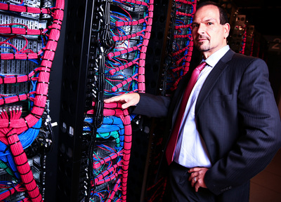 IBM SoftLayer CEO Lance Crosby examines servers at the IBM SoftLayer data center in Dallas, Texas, on Friday, January 17, 2014. IBM announced it is committing more than $1.2 billion to significantly expand its global network of cloud data centers. [Image courtesy of IBM].  (PRNewsFoto/IBM)