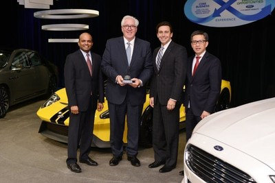 Ford's Raj Nair, Mark Fields and Hau Tai Tang present Bill Kozyra of TI Automotive (with trophy) with the Ford World Excellence Award for Quality for 2015