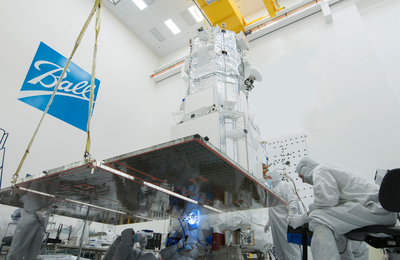 Ball Aerospace technicians inspect a WorldView-3 solar array following completion of environmental tests for the DigitalGlobe commercial remote-sensing satellite scheduled to launch in August from Vandenberg Air Force Base.