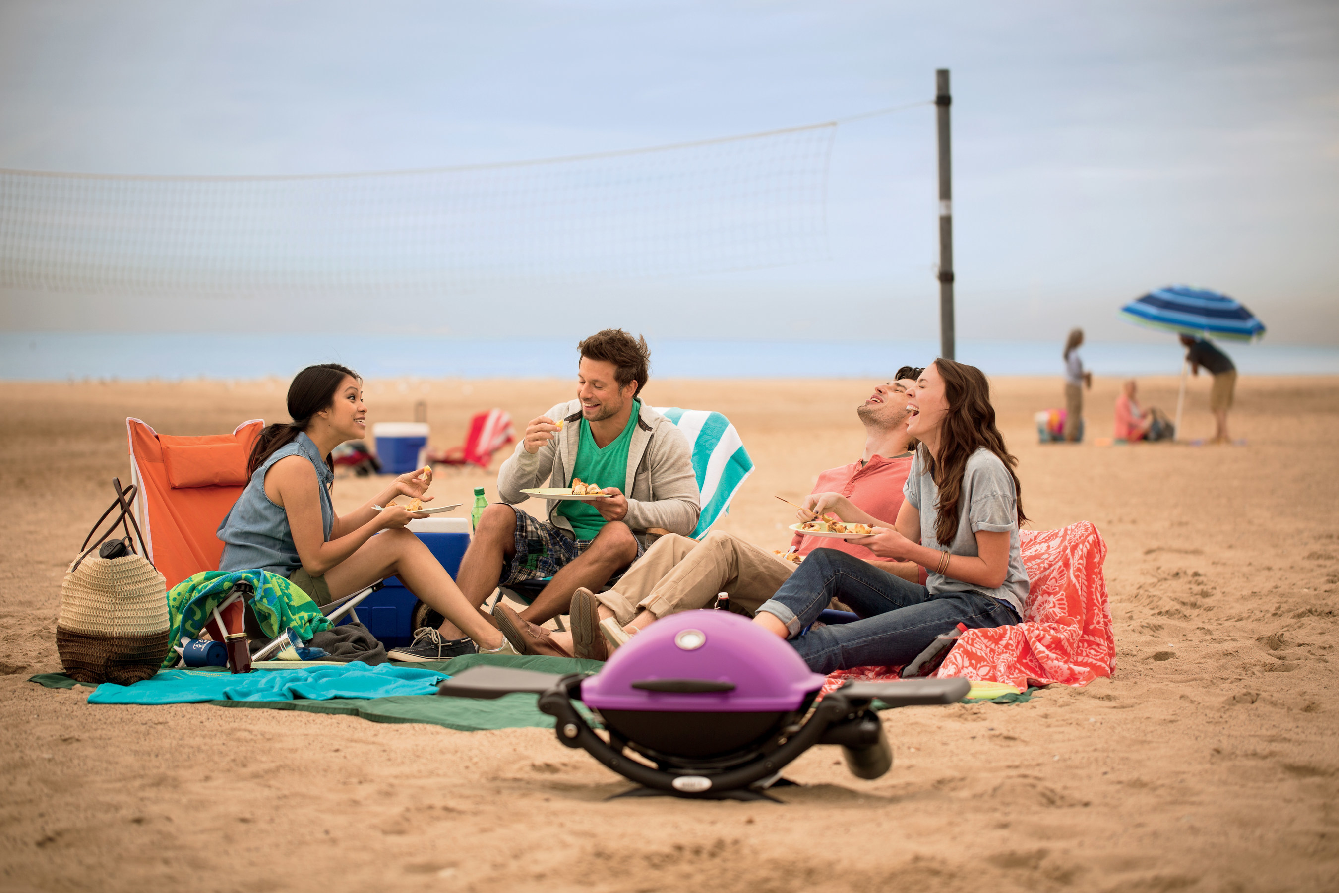 """Weber's new Q1200 gas grills come in six fun colors-blue, purple, fuchsia, orange, black and green.  Fifty-eight percent of all grill owners enjoy grilling away from home*, and weighing just 31 pounds, the Q1200 is the perfect travel companion.  Whether it's a music festival,  """"glamping"""", the beach, or home sweet home, grillers can enjoy great food and high style this summer.  Available nationwide.  Visit www.weber.com.  Source:  The 26th annual Weber GrillWatch(TM) Survey."""