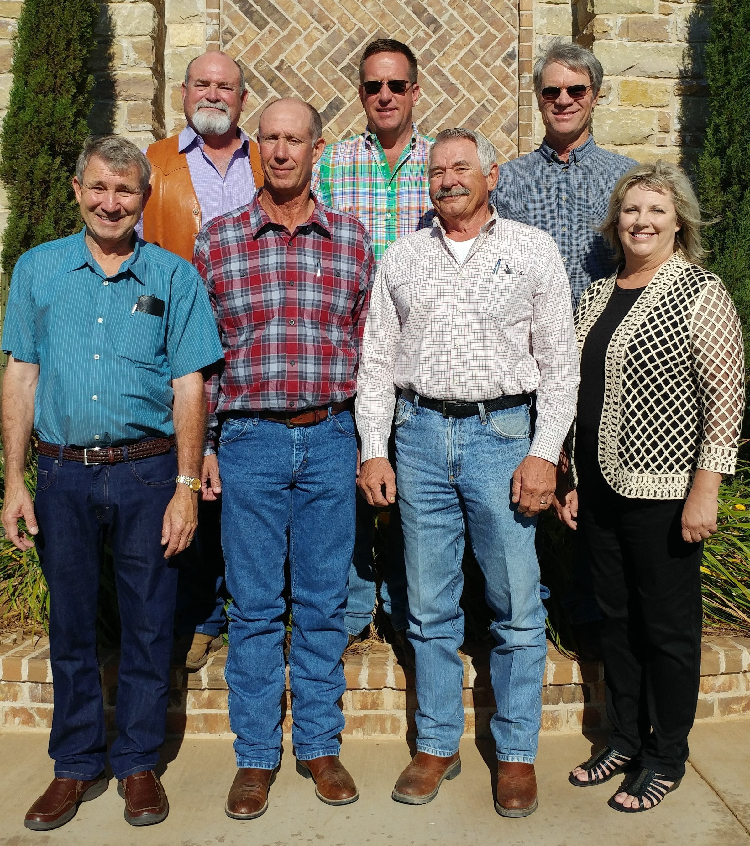The all-farmer Board of Directors for the Texas Organic Cotton Marketing Cooperative is made up of: (front row, from left) Jimmy Wedel, Carl Pepper, Ron Goebel, and Darlene Vogler; (back row from left) Mark Wilkes, Jeff Payne, and Cliff Bingham.