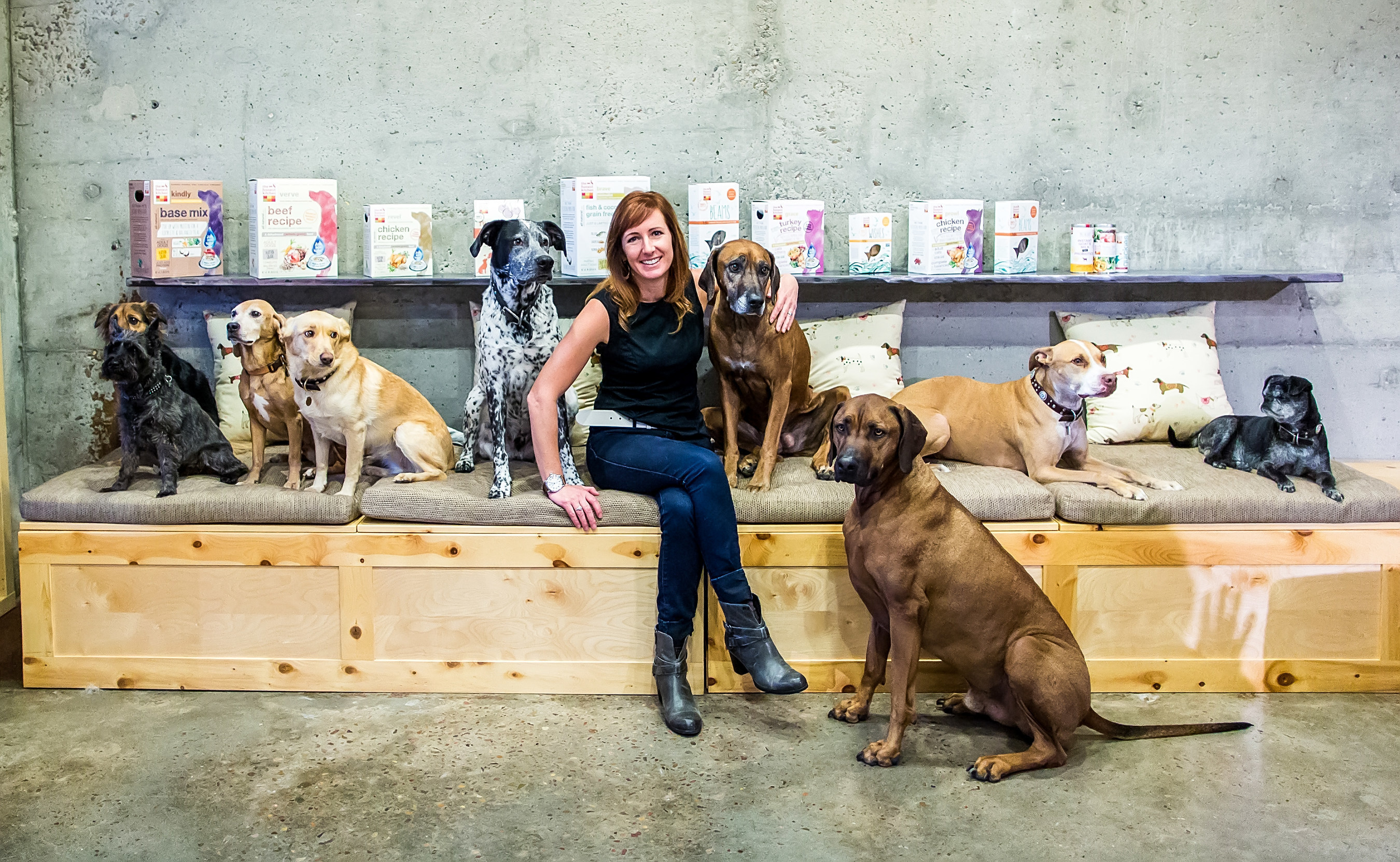 Lucy Postins, founder and CEO of San Diego-based The Honest Kitchen poses with co-woofers. The company, makers of all-natural dehydrated pet foods, supplements and treats, was recognized as a top place to work in America by Entrepreneur and Outside Magazines.