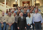 """Georgia Gov. Nathan Deal, electric cooperatives and other utilities gathered at the State Capitol today as members of the Georgia legislature and the public said """"Thank You"""" to linemen for their service and sacrifice. Gov. Deal signed House Bill 767 which requires any motorist approaching utility linemen at an active work site to change lanes or reduce their speed to a reasonable and proper speed below the posted speed limit. Violators could be fined up to $250 per incident."""