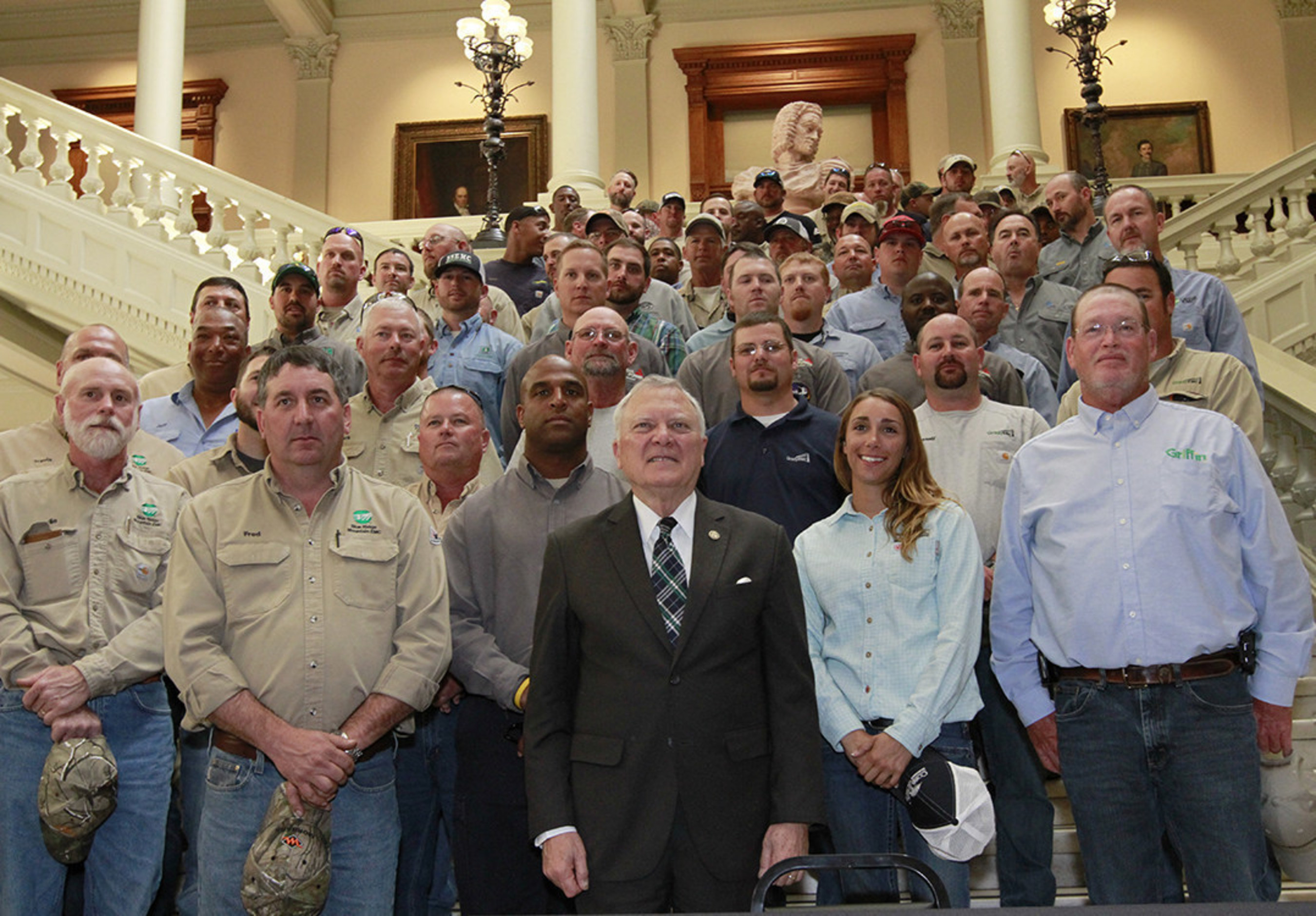 "Georgia Gov. Nathan Deal, electric cooperatives and other utilities gathered at the State Capitol today as members of the Georgia legislature and the public said ""Thank You"" to linemen for their service and sacrifice. Gov. Deal signed House Bill 767 which requires any motorist approaching utility linemen at an active work site to change lanes or reduce their speed to a reasonable and proper speed below the posted speed limit. Violators could be fined up to $250 per incident."