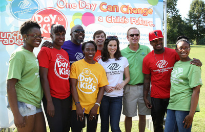 """Grammy Award-winning artist Ne-Yo, Olympic gold medalists Jackie Joyner-Kersee and Gail Devers, actress Heather Roop and radio host Griff join Boys & Girls Clubs of America President and CEO Jim Clark, Lunchables' Michael Campi and Club kids during a field day event in Atlanta on Saturday, September 7. The event kicked off Boys & Girls Clubs of America's """"Day for Kids"""" which invites adults to relive their childhood to help change the lives of kids in need. The nationwide initiative, supported by Lunchables, features hundreds of events at local Boys & Girls Clubs nationwide in September. (PRNewsFoto/Boys & Girls Clubs of America) (PRNewsFoto/BOYS & GIRLS CLUBS OF AMERICA)"""