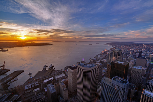 Photographer Mike Reid captures sunset in Seattle over Elliott Bay from Columbia Center's Sky View ...