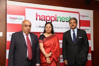 "( L-R) Mr. Arun Nanda, Chairman, Mahindra Lifespace Developers Ltd., Ms.  Anita Arjundas, Managing Director & CEO, Mahindra Lifespace Developers Ltd. and Mr. Anand Mahindra, Chairman, Mahindra Group at the brand launch of Affordable Housing - ""Happinest"""