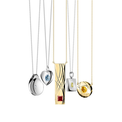 SKY and LIVI's pendants featuring personal, lab-grown diamonds created from the hair women lose due to chemotherapy treatments for cancer. (PRNewsFoto/SKY and LIVI) (PRNewsFoto/SKY AND LIVI)