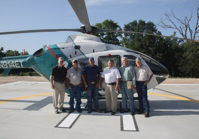 Photo of community leaders at new Anderson County heliport: (Left to right) David Lang, Director of Trinity Valley Electric; Bob Sheppler, Anderson County rancher and contractor; Anderson County Commissioner Joey Hill; Anderson County Judge Robert Johnston; Anderson County Airport Zoning Commission Chairman Elton Bomer; and Airport Zoning Commissioner Bob Hill. (PRNewsFoto/Bradley Oaks Ranch)