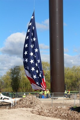 The largest US Flag flown in the world gets launched onto the largest US flagpole. Photo by ACUITY Insurance Company. Arup was technical advisor. (PRNewsFoto/Arup)