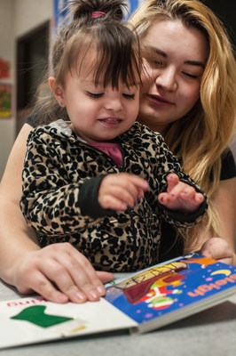 Emma Garcia reads to her daughter Aliyah, 2, during a parent-child group organized by Save the Children at a California preschool. Photo by Susan Warner / Save the Children