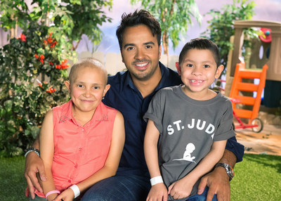 St. Jude supporter Luis Fonsi next to St. Jude patients Olivia and Elias.