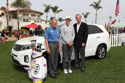Michelle Wie, 2-time LPGA winner, George Brown, executive director of Operation Hero, Tom Loveless, executive vice president  of sales, Kia Motors America.  (PRNewsFoto/Kia Motors America)