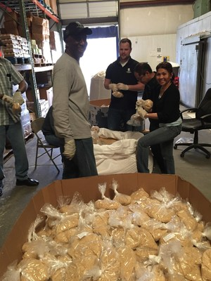 Wounded Warrior Project Alumni volunteer at food bank.