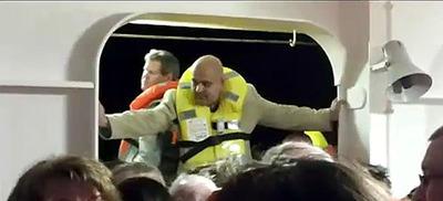 Sandor Feher helping evacuees amid the chaos.  (PRNewsFoto/Ronai & Ronai, LLP)