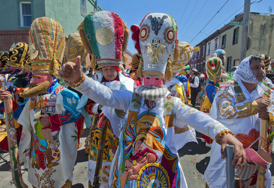 Marchers in Philadelphia's El Carnaval de Puebla en Filadelfia don caricature costumes depicting the Mexican army that prevailed over the French and Turkish forces during the 1862 Battle of Puebla, commonly known as Cinco de Mayo. Many of the bearded masks, beaded capes, headdresses and other costume accessories are crafted in Mexico and, by tradition, are meant to disguise the identities of participants. First introduced to the city in 2007, the parade and festival brings in tens of thousands of marchers from around the U.S. and Mexico.  (PRNewsFoto/Greater Philadelphia Tourism Marketing Corporation, R. Kennedy for GPTMC)