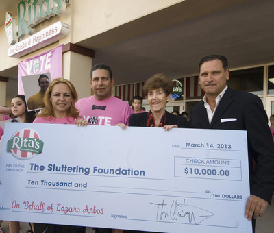 Rita's Chairman Tom Christopoul (right) presents Stuttering Foundation President Jane Fraser (second from right) with a $10,000 donation on behalf of American Idol finalist Lazaro Arbos. They are joined by Lazaro's parents Gisela Andraca and Reinaldo (left) at the Rita's Italian Ice in Naples, Fla.  (PRNewsFoto/Stuttering Foundation)