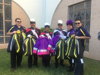 "San Gabriel Valley chapter of the Knights of Columbus donated more than 100 ""Coats for Kids"" during the Dia de los Muertos celebration at Calvary Cemetery Nov. 1, to be distributed to low income families by the ""Adopt-A-Family"" program of the Archdiocese of Los Angeles. Photo Credit: Victor Aleman/Archdiocese of Los Angeles"