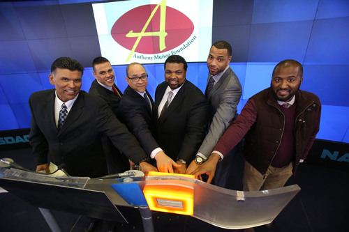 TEAM Services Corporation officers and supporters ring the NASDAQ closing bell on Wednesday, Jan. 29. From left to right: Pro Football Hall of Famer Anthony Munoz, TEAM Services Vice President Michael Munoz, former U.S. Department of Commerce Minority Business Development Agency (MBDA) National Director David Hinson, TEAM Services CEO Andre Farr, New York Knicks power forward Kenyon Martin and 'Best Man Holiday' Director Malcolm Lee. TEAM Services Corp. is a crowd management and event staffing company founded by and for former athletes. (PRNewsFoto/TEAM Services Corporation) (PRNewsFoto/TEAM SERVICES CORPORATION)