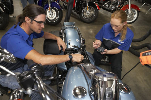 Students at Motorcycle Mechanics Institute in Orlando work on a Harley-Davidson motorcycle.  (PRNewsFoto/Universal Technical Institute, Inc.)
