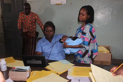 Taking fingerprints of child patients in Benin.  (PRNewsFoto/VaxTrac)