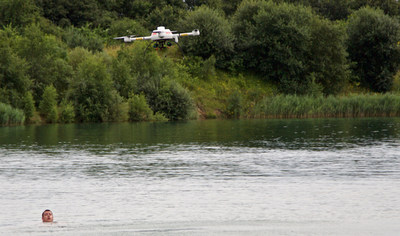A microdrones md4-1000 UAS drops a compact rescue device called RESTUBE; the swimmer in this demonstration was able to grab onto the RESTUBE and float until they could be brought back to safety.