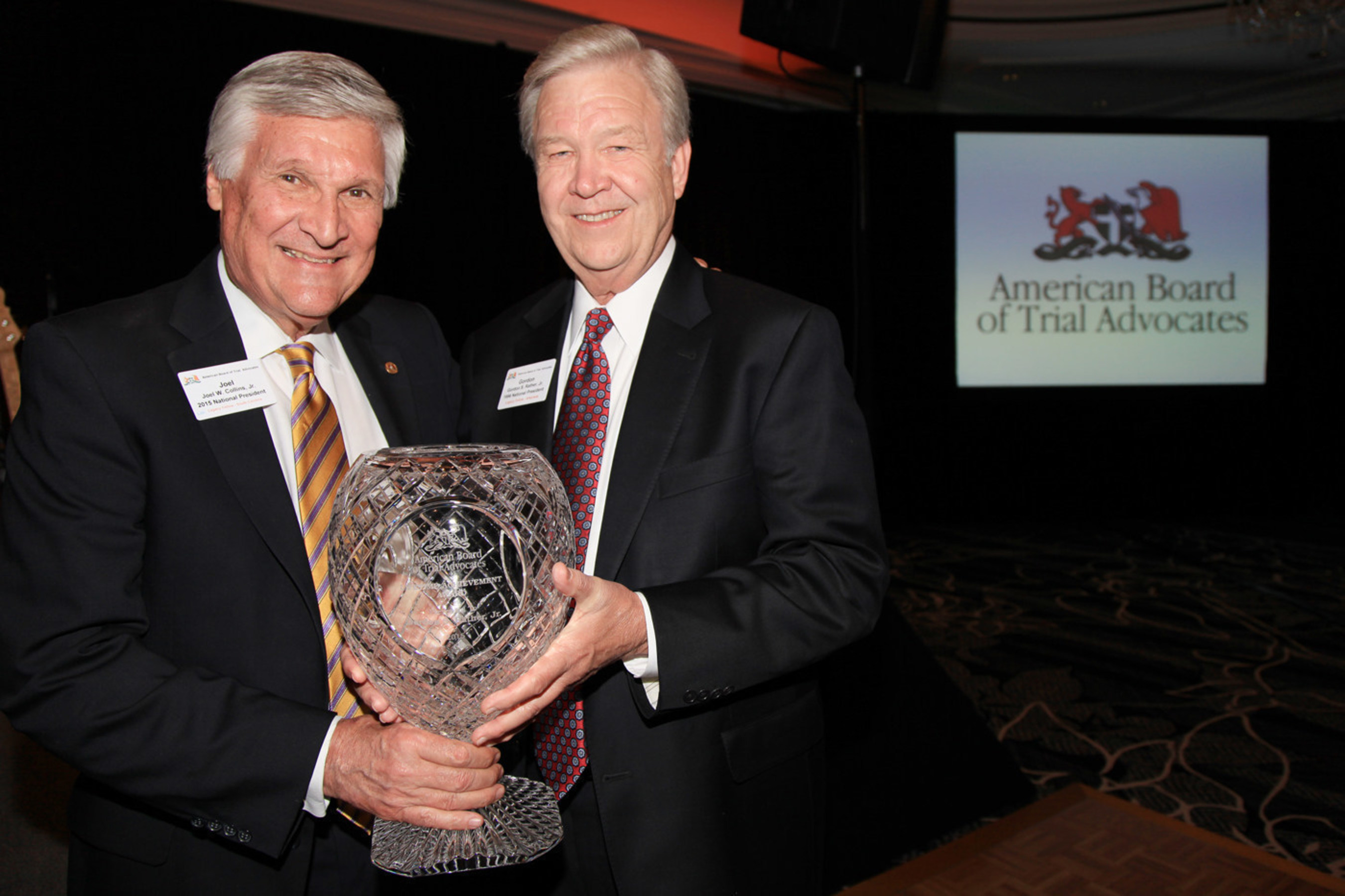 Gordon S. Rather, Jr., (right) receives the Lifetime Achievement Award from National President Joel W. Collins, Jr., of the American Board of Trial Advocates.