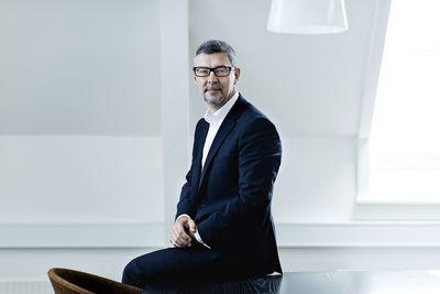 Morten Hjelmsoe sitting in office