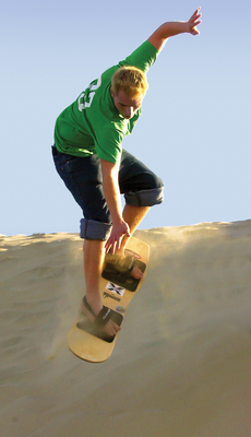Sandboarding the Oregon Dunes in Florence! (PRNewsFoto/Florence Chamber)