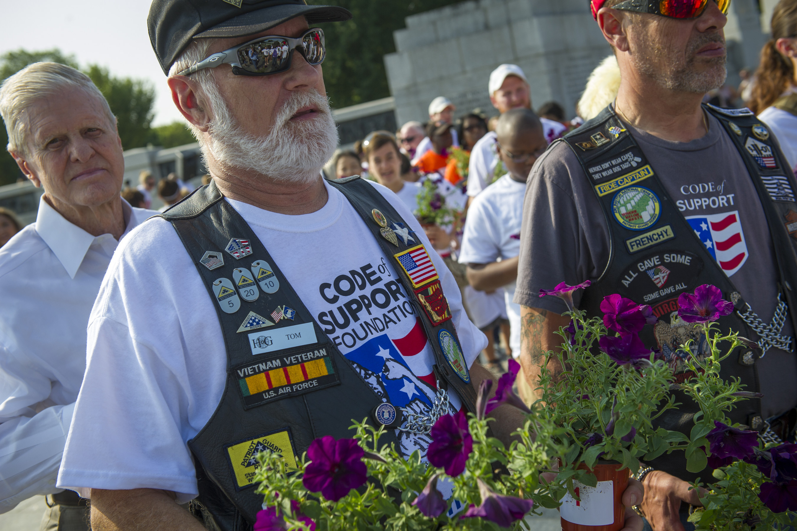 "Members of the Virginia Patriot Guard Riders prepare to pay tribute to Post 9/11 Military Veterans by participating in the Code of Support Foundation's ""Living Wall of Honor"" service project at the World War II Memorial in Washington, D.C. on Sun., Aug. 10. The Living Wall of Honor is comprised of more than 1000 plants and will be on exhibit at the Women In Military Service For America Memorial at the main gate to Arlington National Cemetery where it is expected to remain through September 11, 2014. Photo/Rodney Lamkey (PRNewsFoto/The Code of Support Foundation)"